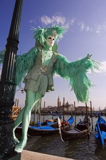 Venice Carnival People in Costumes and Masks on Canal with Gondolas