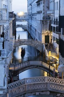 Venice, Veneto, Italy. Bridges over a canal with Bridge of Sights in the background