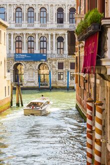 Venice, Veneto, Italy. Buildings and boats in the canals. Ca' Pesaro Palace