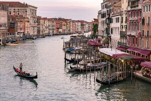 Venice, Veneto, Italy. Buildings and gondola from Rialto Bridge