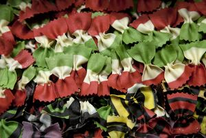 Venice, Veneto, Italy; Coloured pasta on display in a shop window