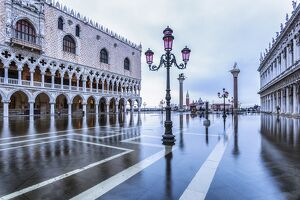 Venice, Veneto, Italy. High water on San Marco Square and Palazzo Ducale on the left