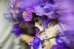 Venice, Veneto, Italy; A mask in movement on Piazza San Marco during Carnival