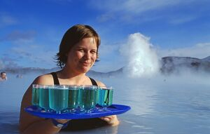 Waitress serving Blue Cocktails at the Blue Lagoon thermal spa