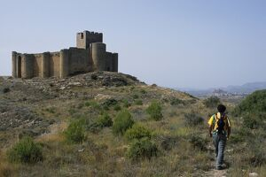 A walker approaches the 13th Century Castillo de Davalillo