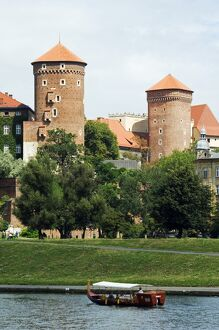 Wawel Hill Castle above Boat on the Vistula River