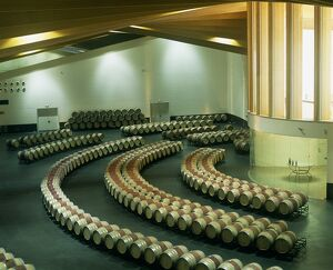 Wine barrels are laid out in artistic curves at Ysios winery