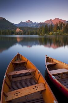 Wooden boats on Strbske Pleso lake in the Tatra Mountains of Slovakia, Europe. Autumn