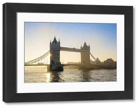 United Kingdom, England, London. Early morning sun rising behind Tower Bridge over the River Thames