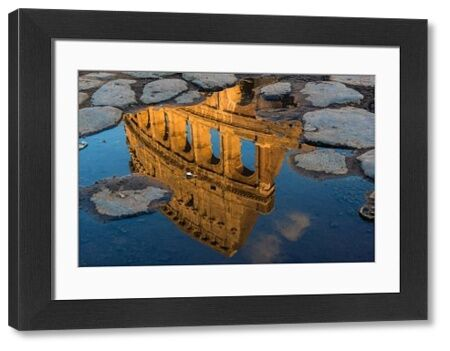Colosseum or Coliseum reflected in a puddle at sunset, Rome, Lazio, Italy