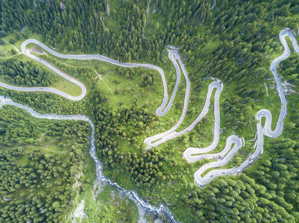 Aerial view of curves of the road between woods, Maloja Pass, Bregaglia Valley, canton