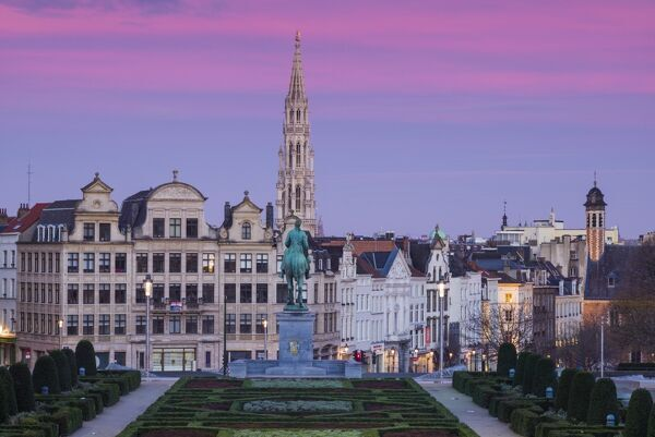 Belgium, Brussels, Mont des Arts, city skyline with Hotel de Ville tower, dawn