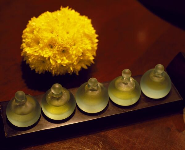 Bottles of scented oils in the spa of the Chedi Hotel