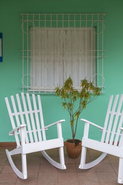 Cuba, Pinar del Rio Province, Vinales, Vinales town, Rocking chairs outside house
