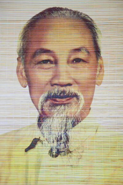 Ho Chi Minh portrait on bamboo scroll, Hanoi, Vietnam