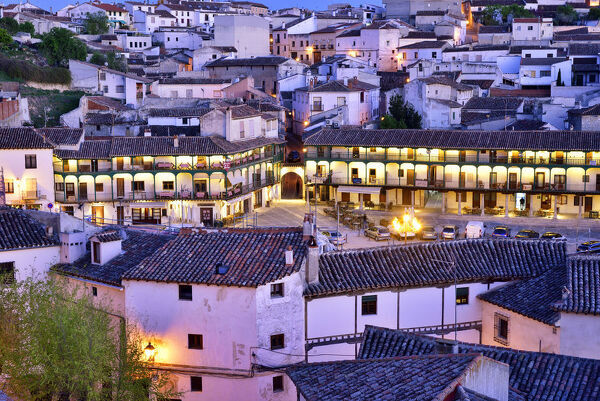 The old town of Chinchon with the 15-17th century Plaza Mayor at dusk. Castilla la Mancha, Spain