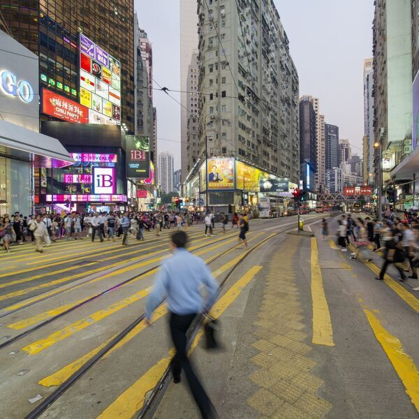 Pedestrians and traffic at a busy road crossing in Causeway Bay, Hong Kong Island, Hong Kong, China