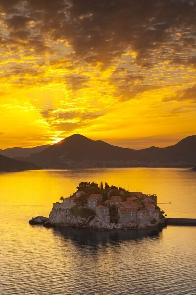 The picturesque island village of Sveti Stephan illuminated at sunset, Sveti Stephan, Montenegro