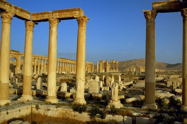 Pillars of the 'Great Colonnade' stretch into the distance at Palmyra [aka Tadmor], a deserted city that despite Roman and Greek influences remained largely independent of Rome until its downfall in 273 AD