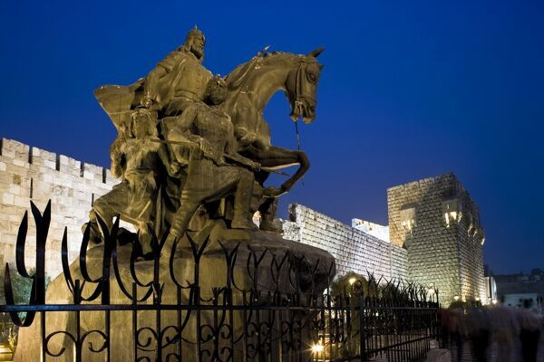 A statue of Saladin stands in front of the citadel, Damascus, Syria