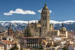 City skyline with the Gothic Cathedral and the snowy mountains of Sierra de Guadarrama