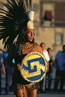 Dancer in Aztec costume performing in Constitution