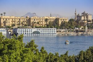 Egypt, Luxor, View of Nile cruise boats infront of The Winter Palace Hotel