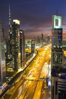 Elevated view at dusk over Downtown & Sheikh Zayed Road looking towards the Burj Kalifa