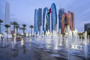 Etihad Towers time lapse viewed over the fountains of the Emirates Palace Hotel, Abu Dhabi
