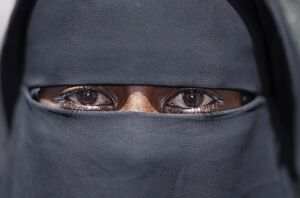 The eyes of a Lamu woman wearing a traditional black