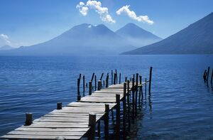 Fishing jetty on Lake Atitlan with volcanoes Toliman and Atitlan behind.