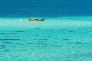 Ko Lipe, Satun Province, Thailand. Traditional long tail boat in turquoise waters