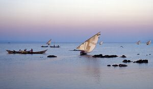Luo fishing boats leave the eastern lakeshore of Lake