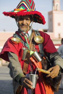 A Moroccan water seller in traditional dress in the Djemaa el Fna