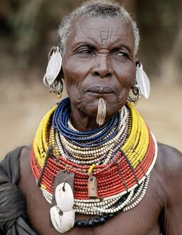 An old Turkana woman wearing all the finery of her tribe