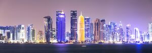Qatar, Doha. Skyline with skyscrapers, at night from the Corniche