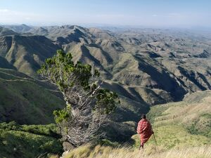 A Samburu warrior looks out over a vast expanse of