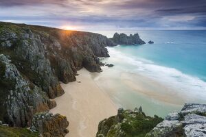 Sunrise over Pednvounder Beach at the Logan Rock, Cornwall, England
