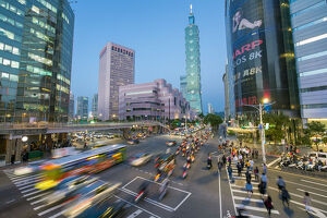 Taiwan, Taipei, traffic in front of Taipei 101 at a busy downtown intersection in