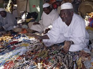 Traders offer a large variety of beads for sale in