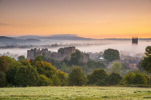 UK, England, Shropshire, Ludlow, Ludlow Castle and St Laurence's Church at Sunrise
