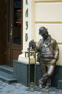 Ukraine Lviv Old Town Unesco World Heritage Bronze Statue outside Cafe