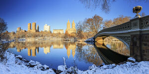 Usa, New York City, Manhattan, Central Park, Bow Bridge and Upper West Side Buildings