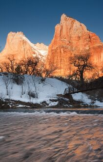 USA, Utah, Zion National Park, Mountain Sunrise by the North Fork Virgin River. winter