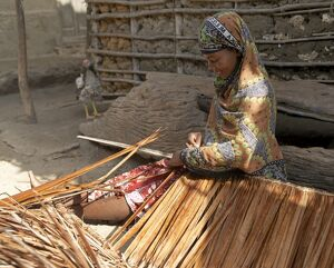 A woman makes makuti