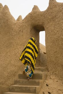 Woman outside Mud Mosque in Segoukoro, Segou, Mali